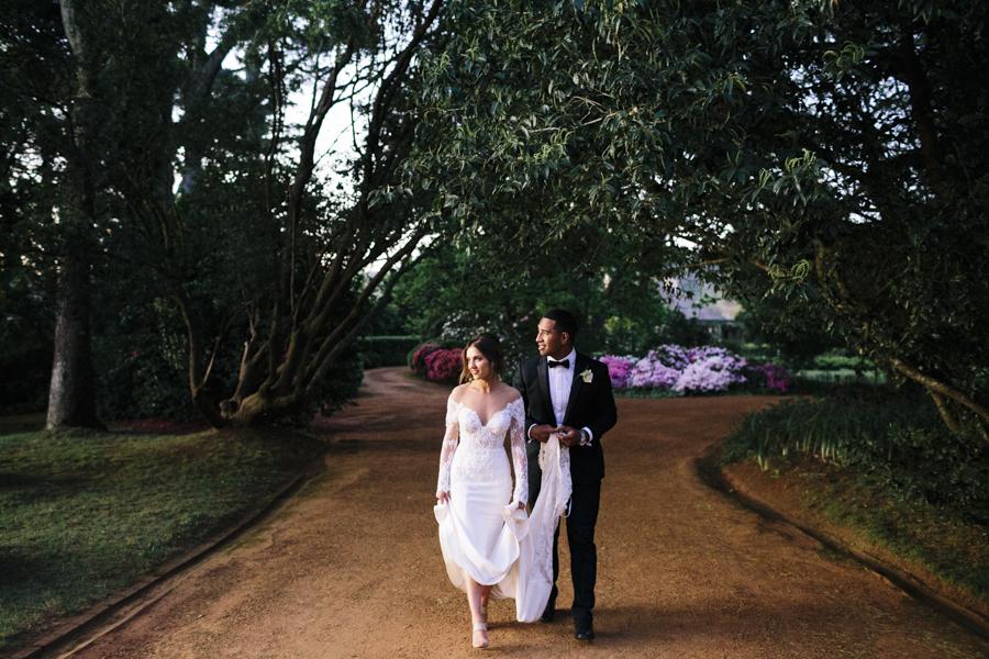 Bendooley-estate-wedding-southern-highlands-berrima-photographer-julia-sami-bride-groom-sunset-spring-walking-dusk-gown