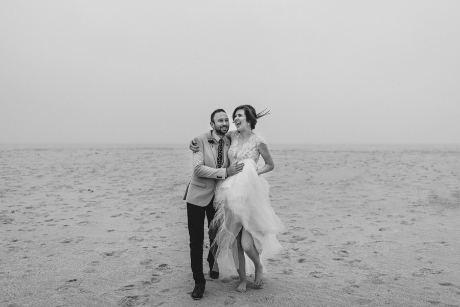bride-groom-running-south-coast-new-south-wales-beach-wedding-black-white