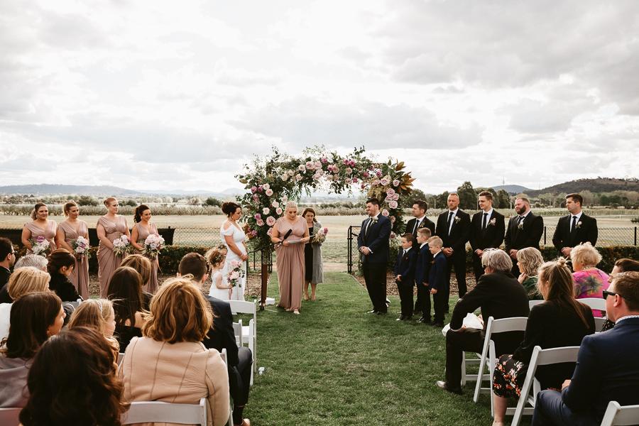 pialligo-estate-wedding-photographer-ceremony-venue-canberra-spring-floral-arch-pia-jade-styling-florist