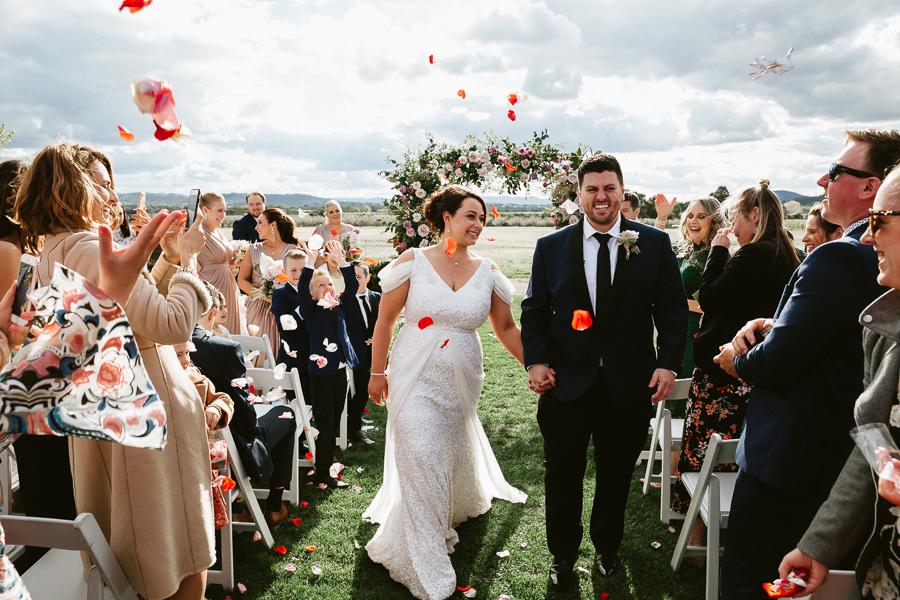 confetti-toss-pialligo-estate-canberra-wedding-venue-bride-groom-flower-petals